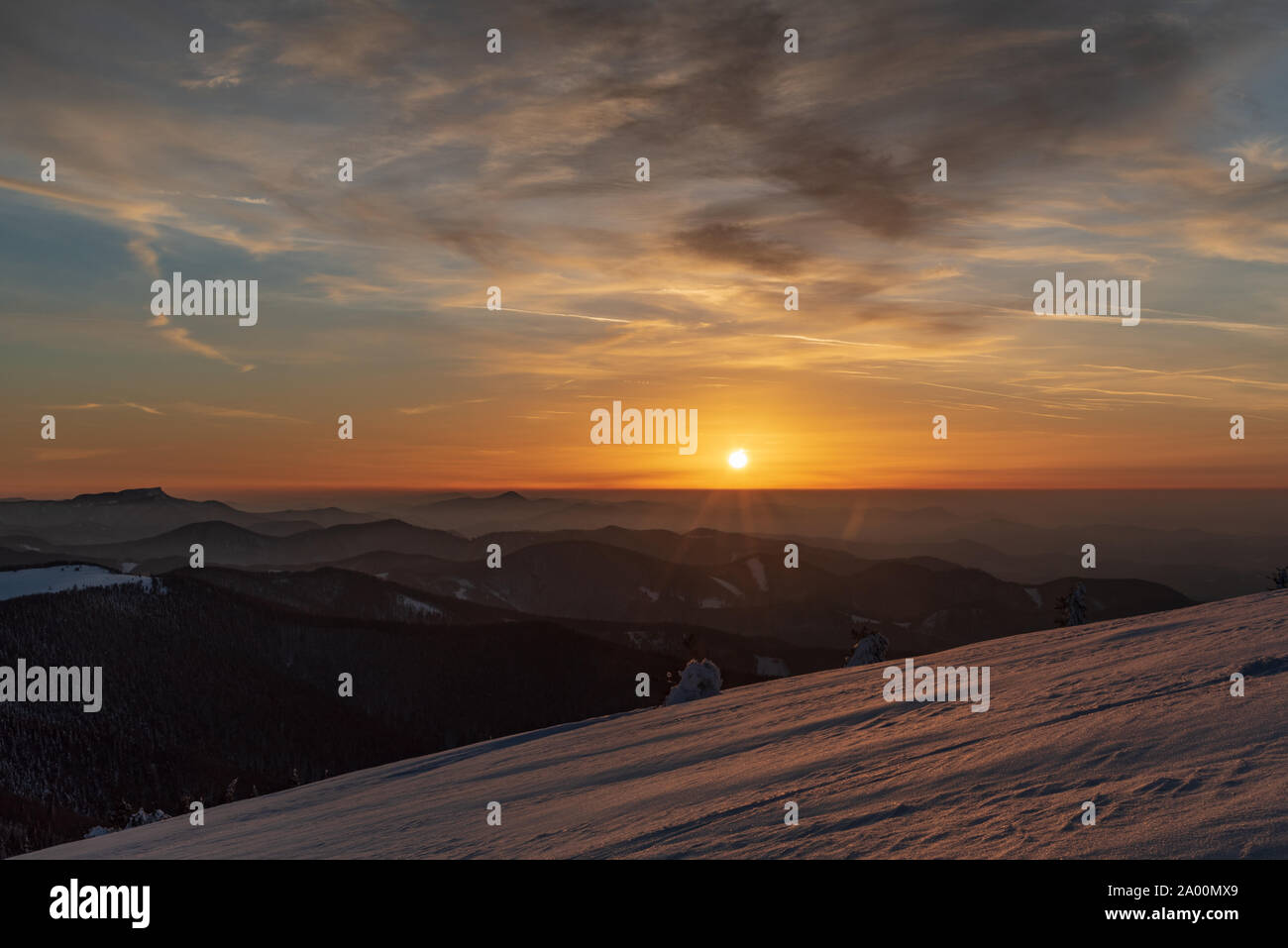 sunset from Veterne hill on Martinske hole in Mala Fatra mountains in Slovakia during winter with colorful sky Stock Photo