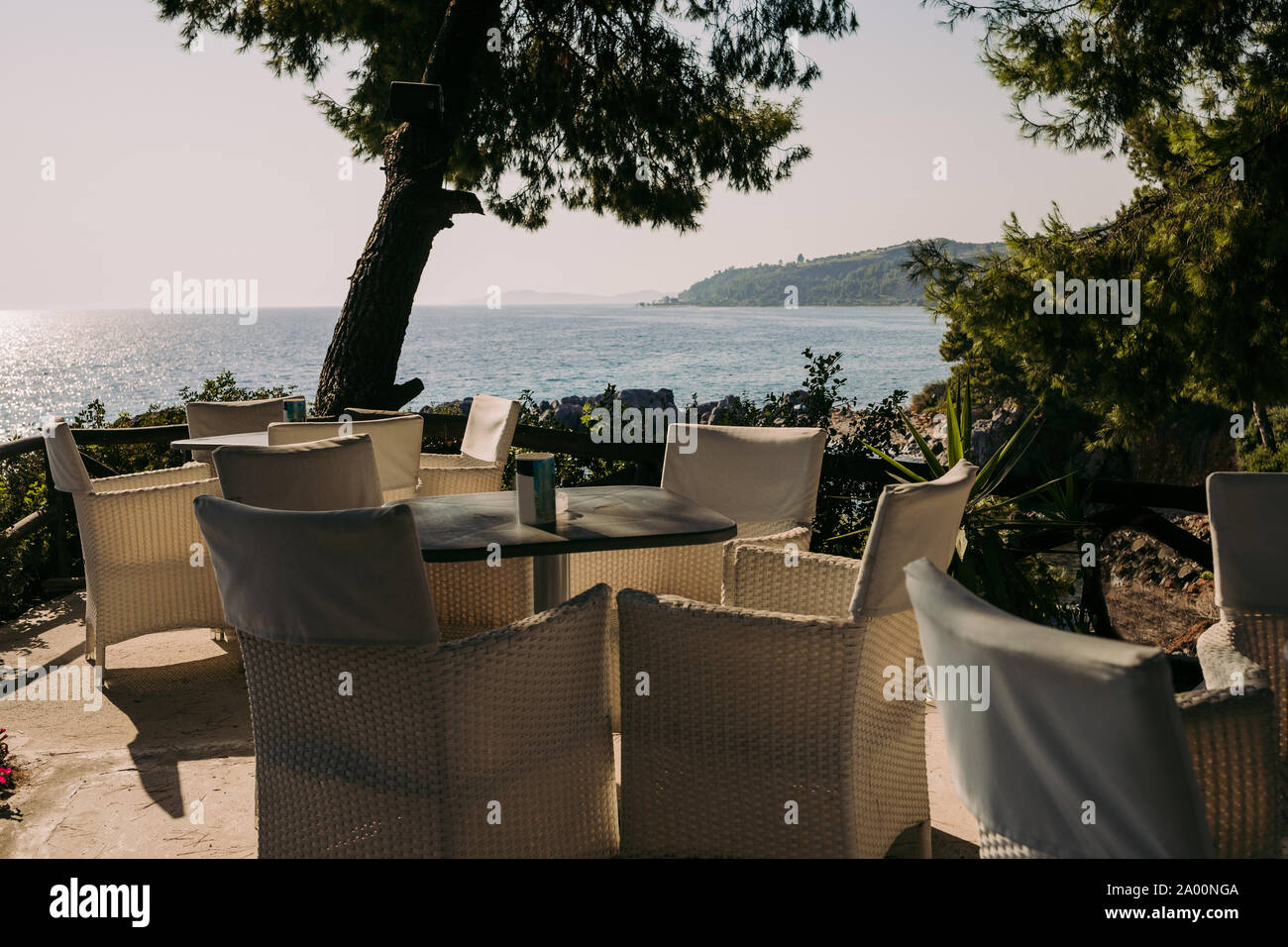 wicker chairs and tables in a summer cafe with sea views. Restaurant sea terrace Stock Photo