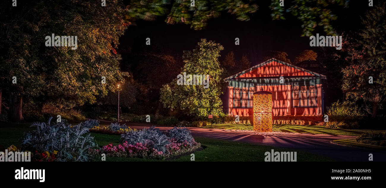Valley Gardens, Harrogate, United Kingdom. 18th September, 2019. Eddie Roberts' sculpture is lit up overnight in the Valley Gardens, celebrating the heritage of the town and welcomes the world as the UCI World Championships take place between 21 to 29 September 2019 in and around Harrogate North Yorkshire, UK. Credit: Caught Light Photography/Alamy Live News. Stock Photo