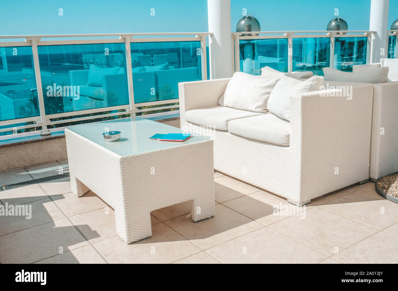 White Outdoor Furniture Soft Sofas And Rattan Chairs With Cushions And A Table With A Glass Top Place To Relax On The Terrace Of The Resort Stock Photo Alamy