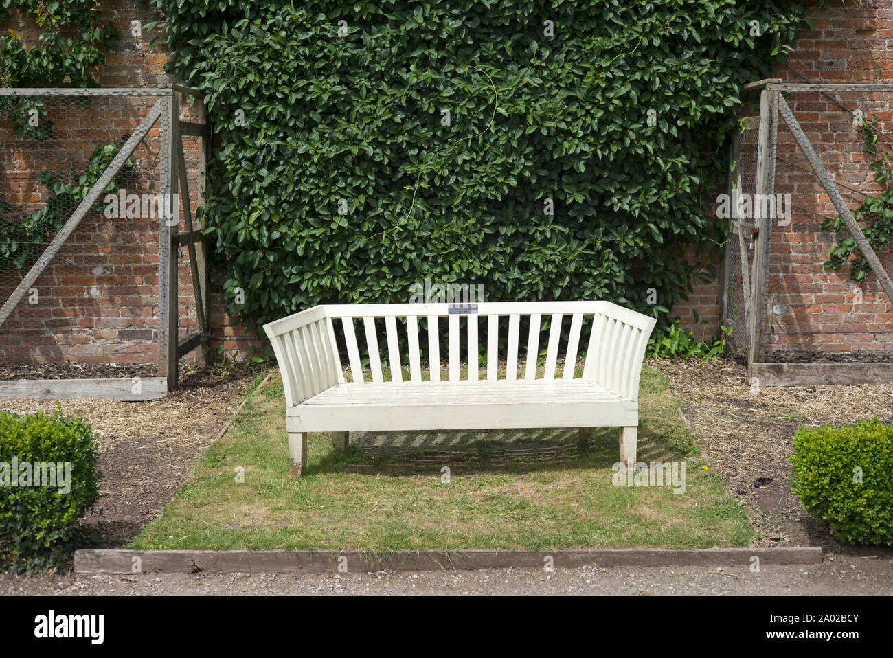 Excellent Isolated White Bench Seat In Country Garden Stock Photo Ncnpc Chair Design For Home Ncnpcorg