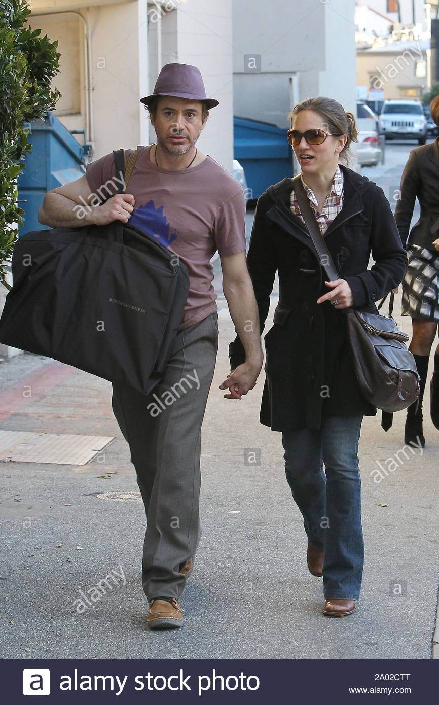 """Beverly Hills, CA - Robert Downey Jr. and wife Susan Levin share a lovable conversation while holding hands during a mini high end shopping spree this afternoon. The """"Sherlock Holmes"""" star looked to get some nice threads at Bottega Veneta and a hefty purchase at the Gucci store. GSI Media February 10, 2010 Stock Photo"""