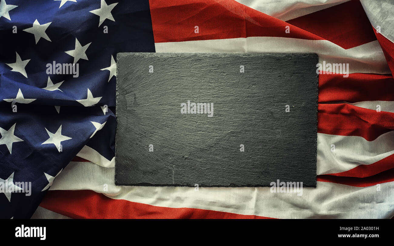American flag on a black background. Space for text. Stock Photo