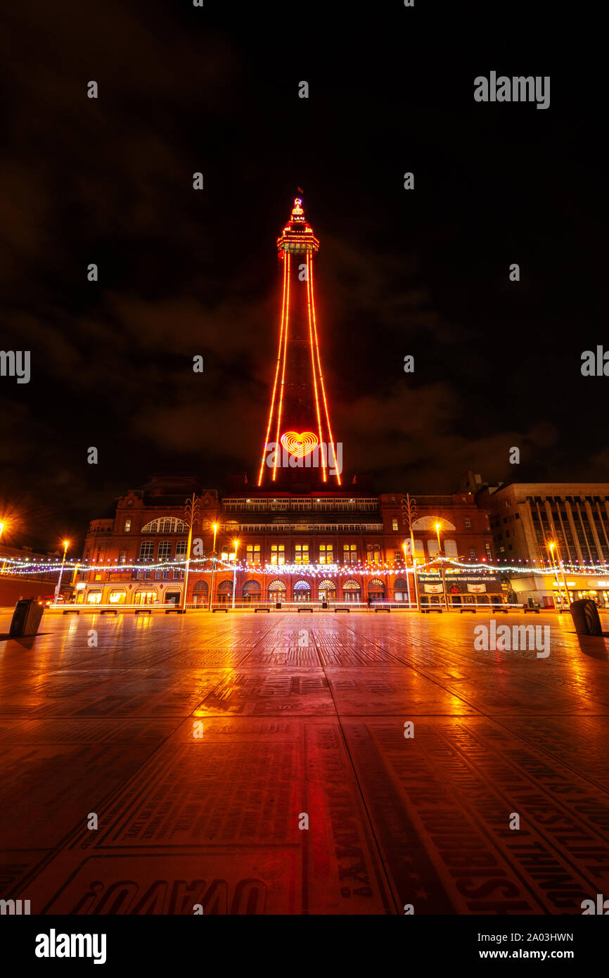 Blackpool Tower during the Blackpool Illuminations with the lights reflected in the Comedy Carpet, a tribute to all the comedians that have entertaine Stock Photo