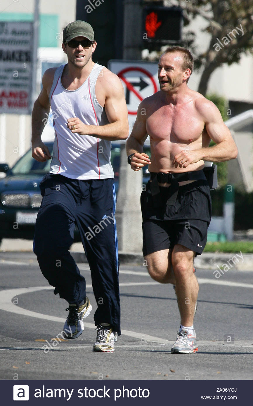 Santa Monica Ca Ryan Reynolds Is Looking More Buffed And Lean While Training With The Shirtless Guy Here Accompanying Him On A Run Through Santa Monica Gsi Media October 26 2008
