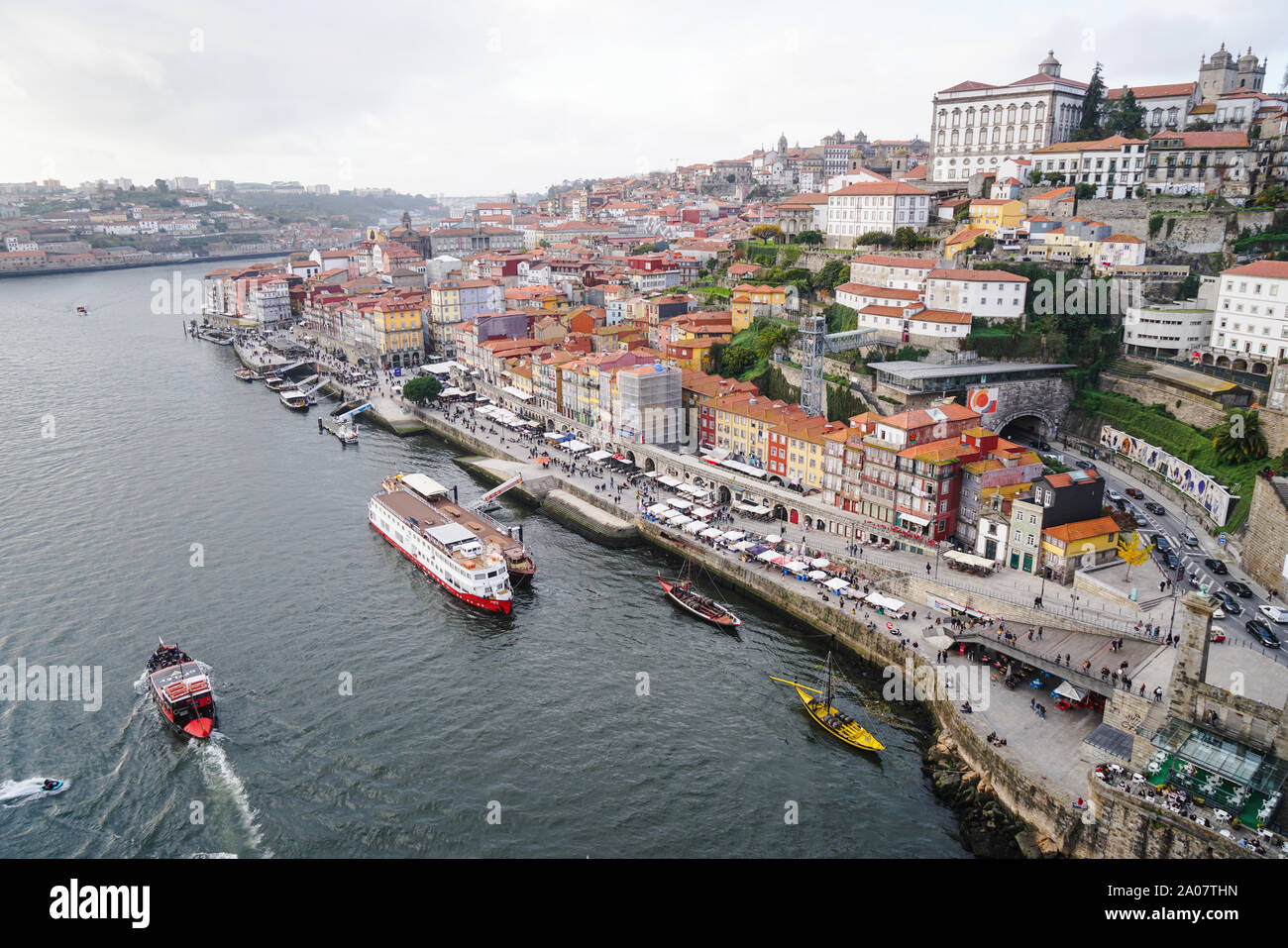 Porto, Portugal - December 2018: View of the Ribeira area and the Douro River with several tourist boats. Stock Photo