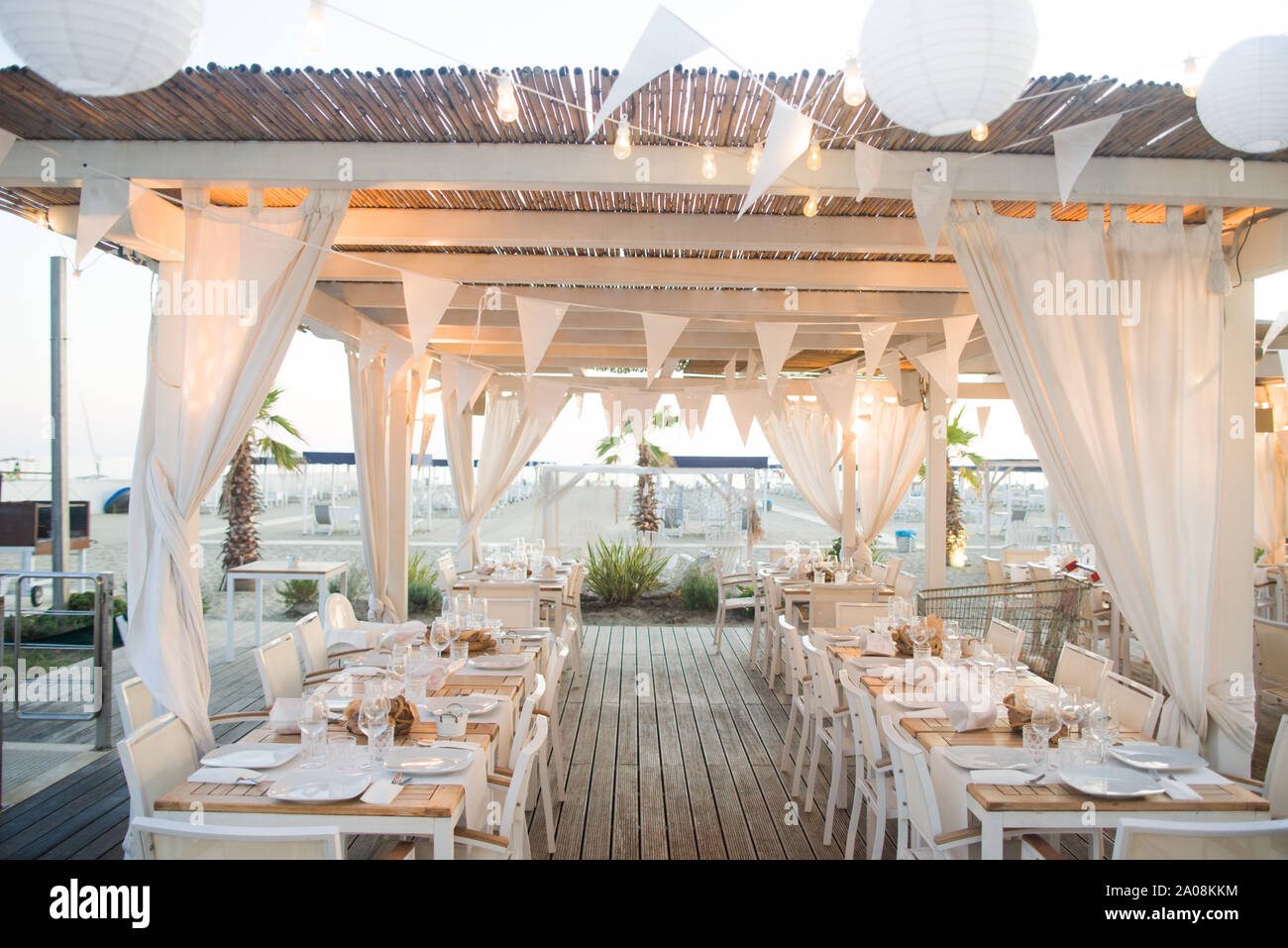 Beautiful Wedding Setup Tables On The Beach Stock Photo