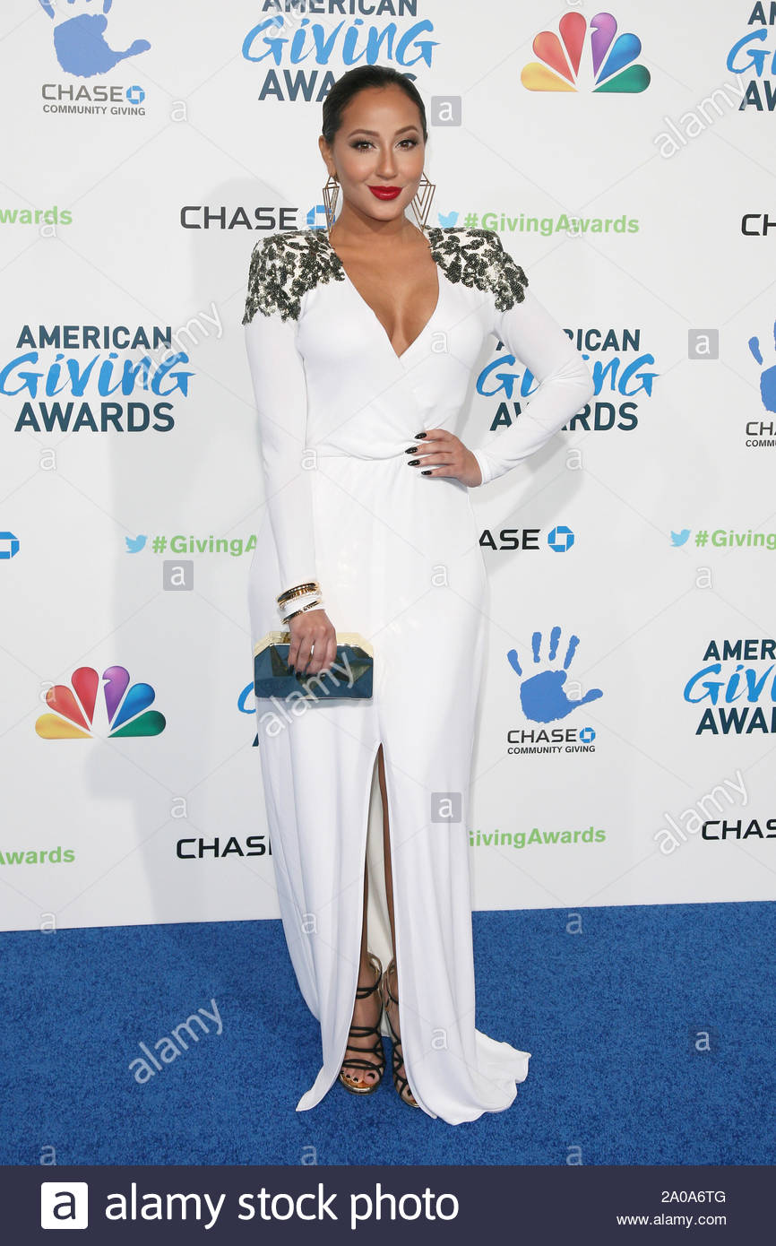 Pasadena, CA - Adrienne Bailon arrives at the 2012 American Giving Awards, presented by Chase, held at the Pasadena Civic Auditorium. AKM-GSI December 7, 2012 Stock Photo