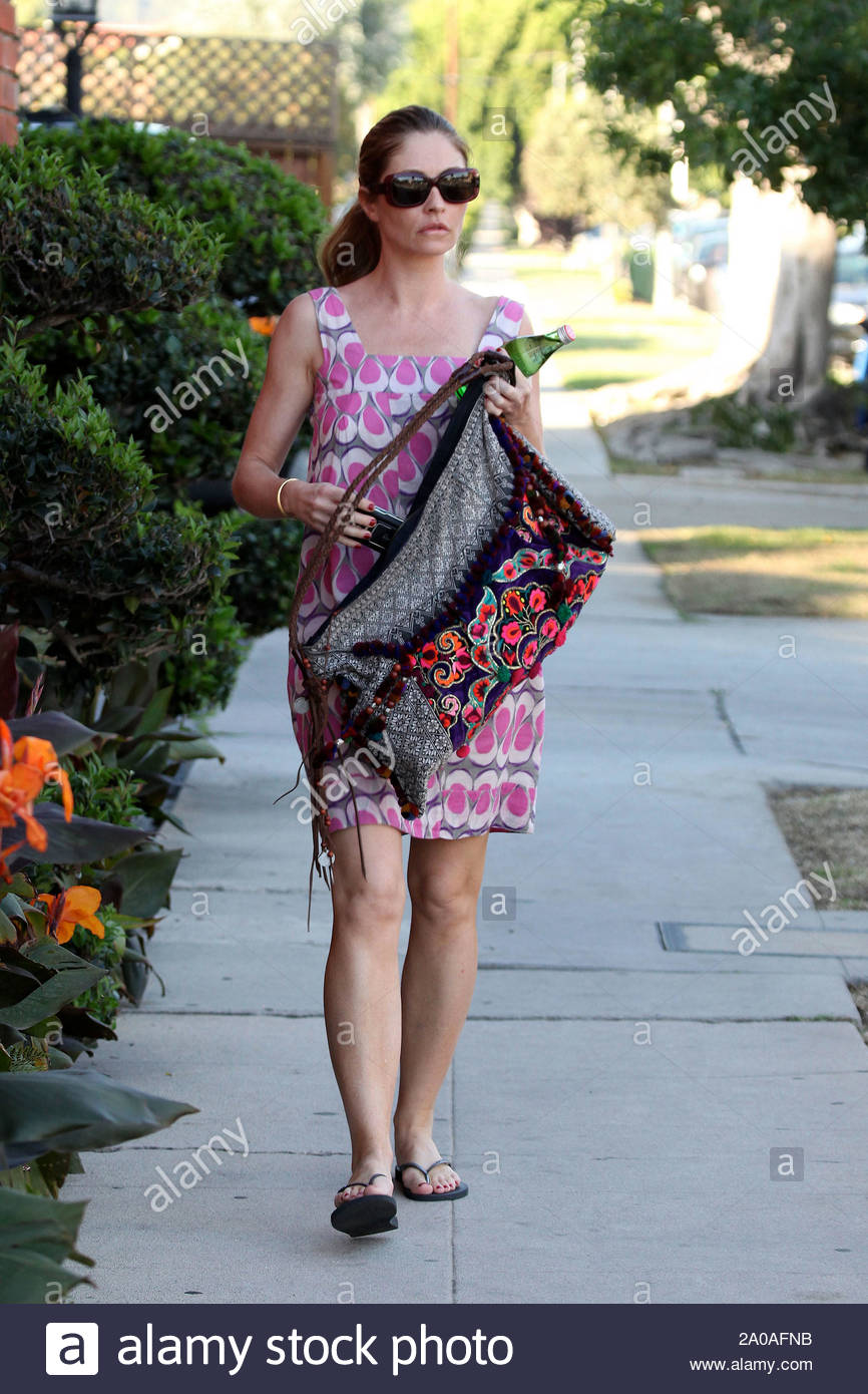 West Hollywood, CA - Rebecca Gayheart heads to her local nail salon today and relaxes while getting a manicure and pedicure. Rebecca looked to catch up on her gossip, as she read through a stack of tabloid magazines during her visit. GSI Media November 4, 2010 Stock Photo