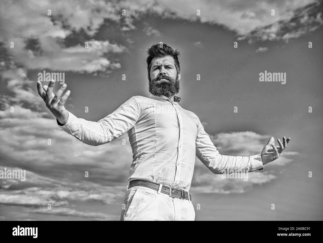 Self proud feeling. Hipster beard and mustache looks attractive white shirt. Guy enjoy top achievement. Superiority and power. Man bearded hipster formal clothes feels proud of himself sky background. Stock Photo
