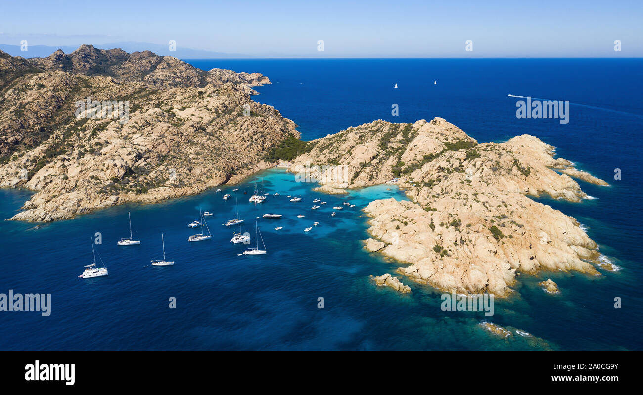 View from above, stunning aerial view of Cala Coticcio also known as Tahiti with boats and yachts floating on a turquoise clear water. Stock Photo