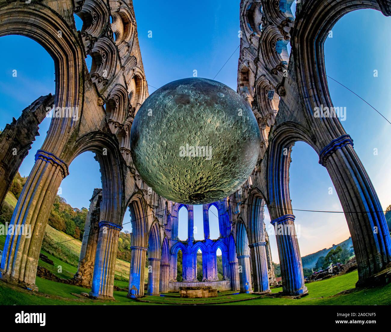 ILLUMINATING RIEVAULX event at Rievaulx Abbey, North Yorkshire, UK. Featuring Museum of the Moon, by Luke Jerram. Stock Photo