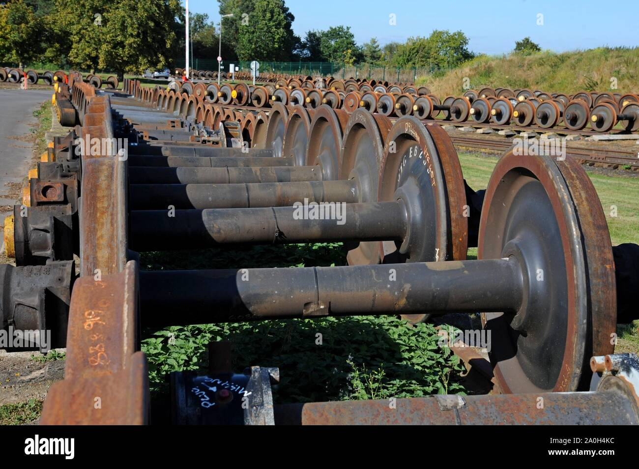 Rows of spare wheelsets for DMU trains and coaches lined up in storage at Quinton Rail Tech Centre Stock Photo