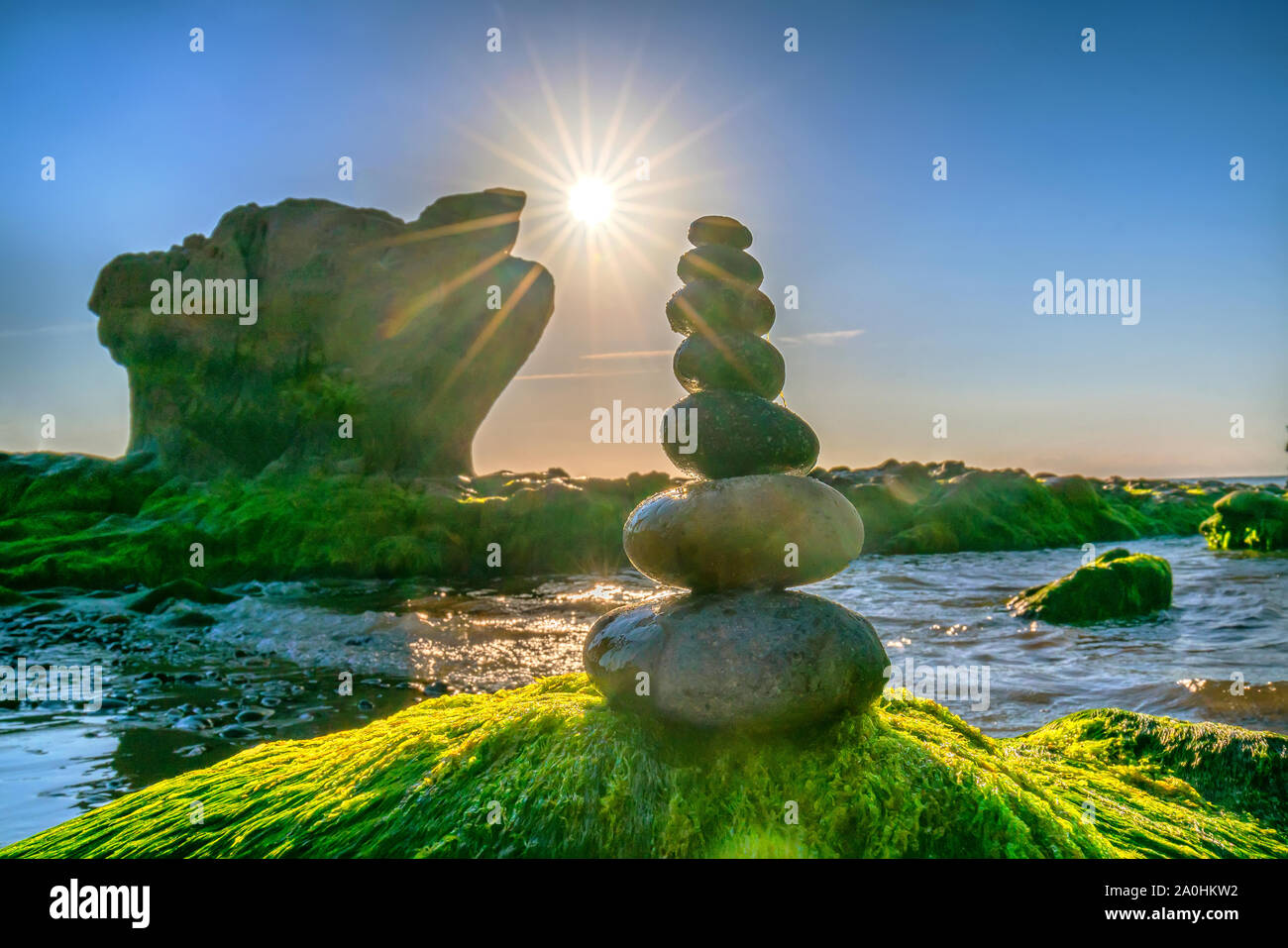 Stacked Pebbles Art On Mossy Rocks Welcomes Beautiful New Day