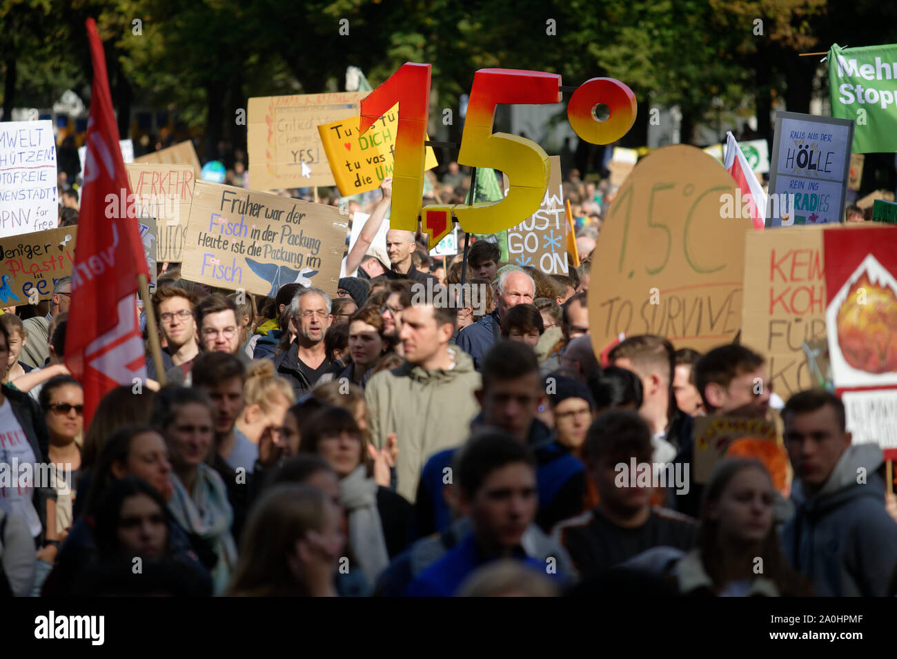 Bonn, Germany. 20th Sep, 2019. Several thousand people demonstrate at the Friday for Future demonstration for more climate protection. Demonstrators are holding up a large 1.5. The demonstrators follow the call of the movement Fridays for Future and want to fight for more climate protection. They want to support the calls for strikes and protests all over the world. Credit: Henning Kaiser/dpa/Alamy Live News Stock Photo