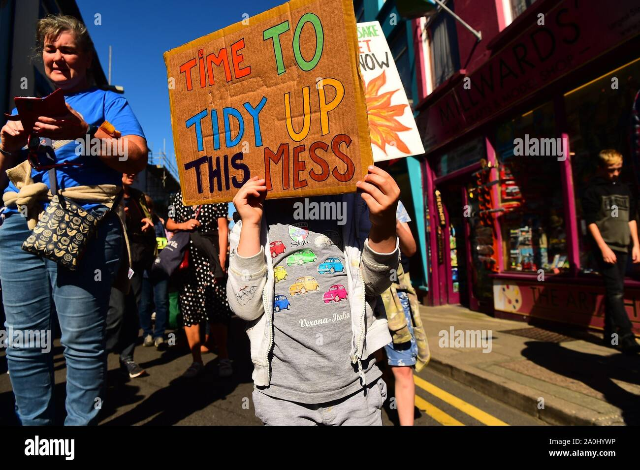 Aberystwyth Wales UK Friday 21 September 2019 Hundreds of school pupils, students and other supporters marched through the streets of Aberystwyth as part of 'Earth Strike', a global series of events to protest about and raise awareness of the threat of climate change to the planet. The protests are timed to take place 3 days before the UN emergency climate summit on 23rd September.  photo credit Keith Morris/Alamy Live News Stock Photo