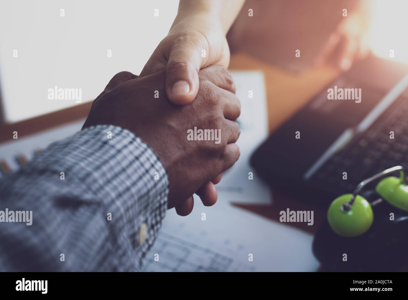 Two colleague shaking hands together celebrating finished work. Business concept. Stock Photo