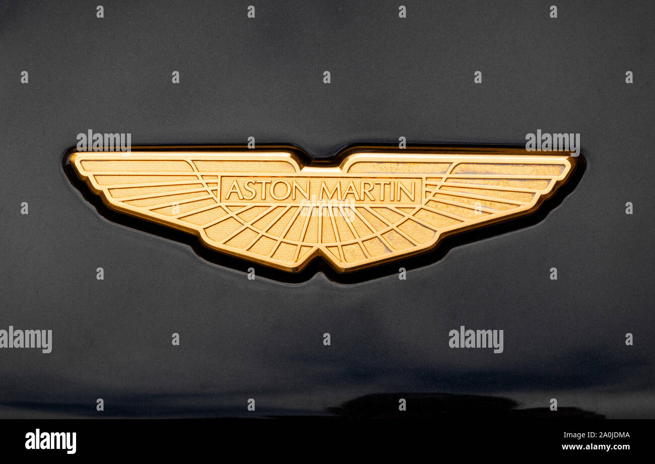 The gold wings logo of Aston Martin on a car hood Stock Photo