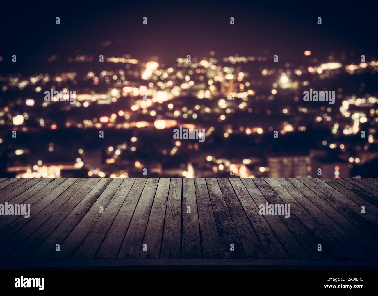 View from wooden plank above phuket town at night Stock Photo