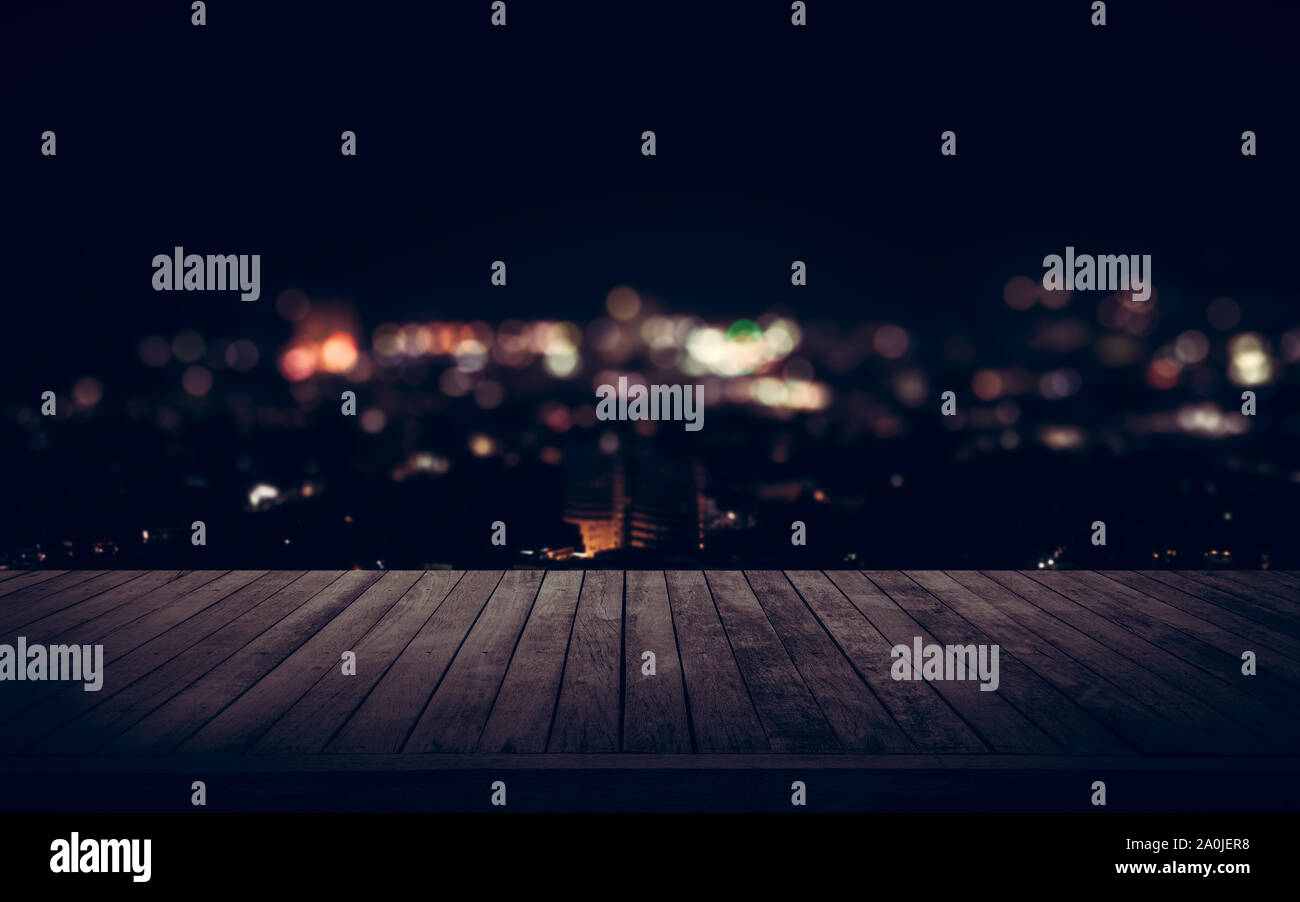 View from wooden plank above the town at night Stock Photo