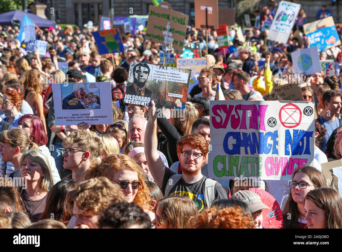 """Glasgow, UK. 20 September 2019. Several thousand turned out to take part in the """"Scottish Youth Climate Strikers"""" march from Kelvingrove Park, through the city to an assembly in George Square to draw attention to the need for action against climate change. This parade was only one of a number  that were taking place across the United Kingdom as part of a coordinated day of action. Credit: Findlay / Alamy News. Stock Photo"""