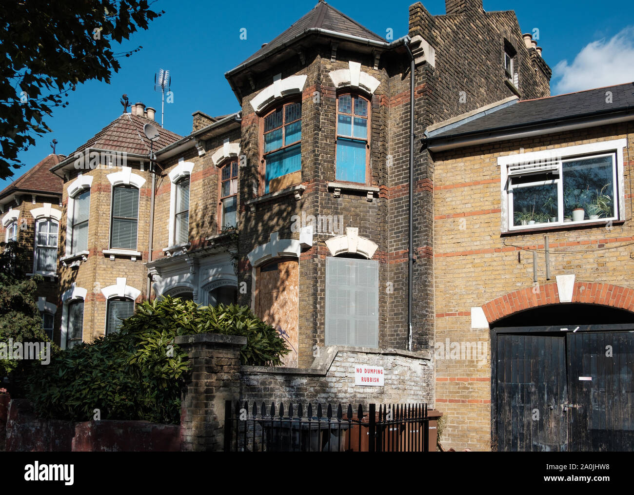 Boarded up derelict housing in Clapton, Hackney, East London, UK Stock Photo