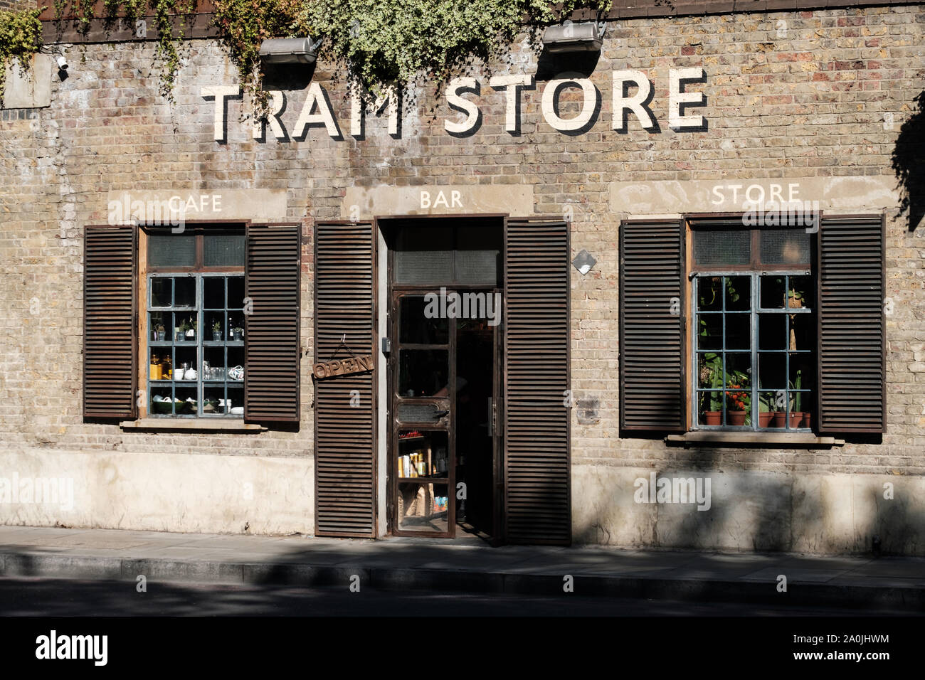 The Tram Store in Clapton, Hackney, East London, a hipster cafe serving vegan food set in the old Clapton Tram Depot. Stock Photo