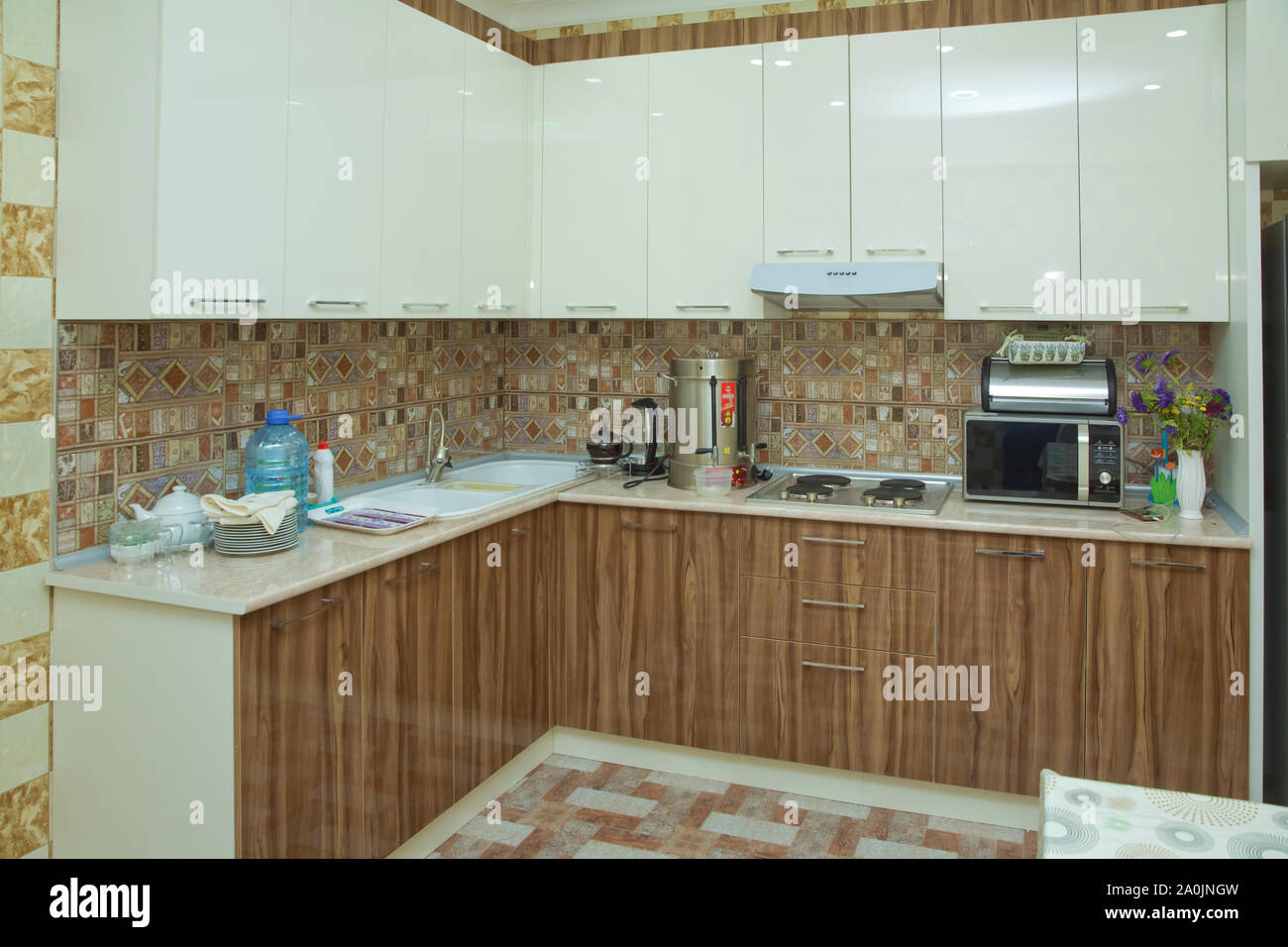 Brown And White Kitchen Design Refrigerator Modern Kitchen With Brown Kitchen Cabinets Oversized Kitchen Stylish Interior With Dining Stock Photo Alamy