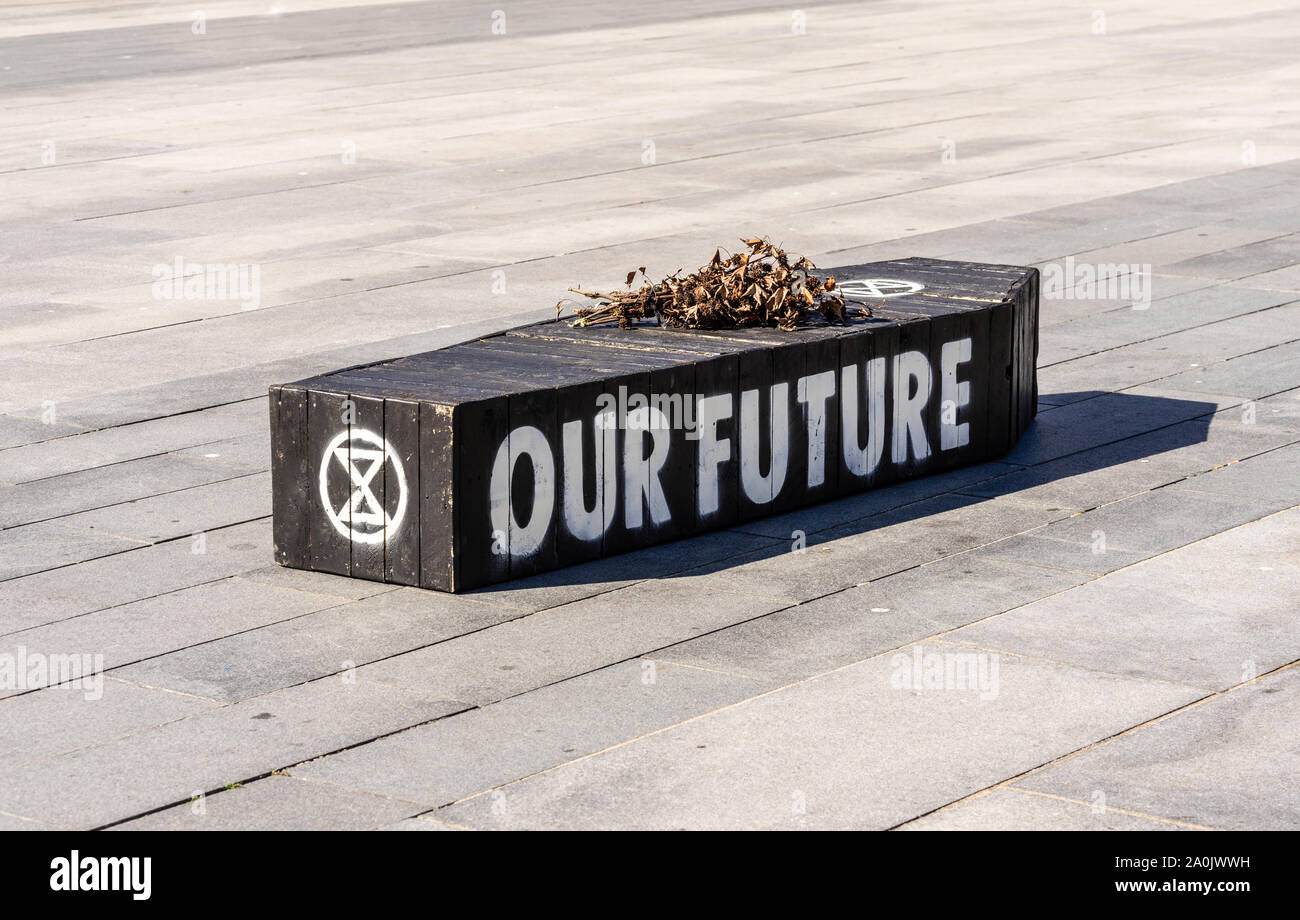 Southampton, UK. 20/09/2019: A black coffin with 'Our Future' written on it and wilted flowers put on top by the Extinction Rebellion Group symbolising a bleak future as we are facing a dying planet as a result of the current climate crisis. Climate strike protest in Southampton, England, UK Stock Photo