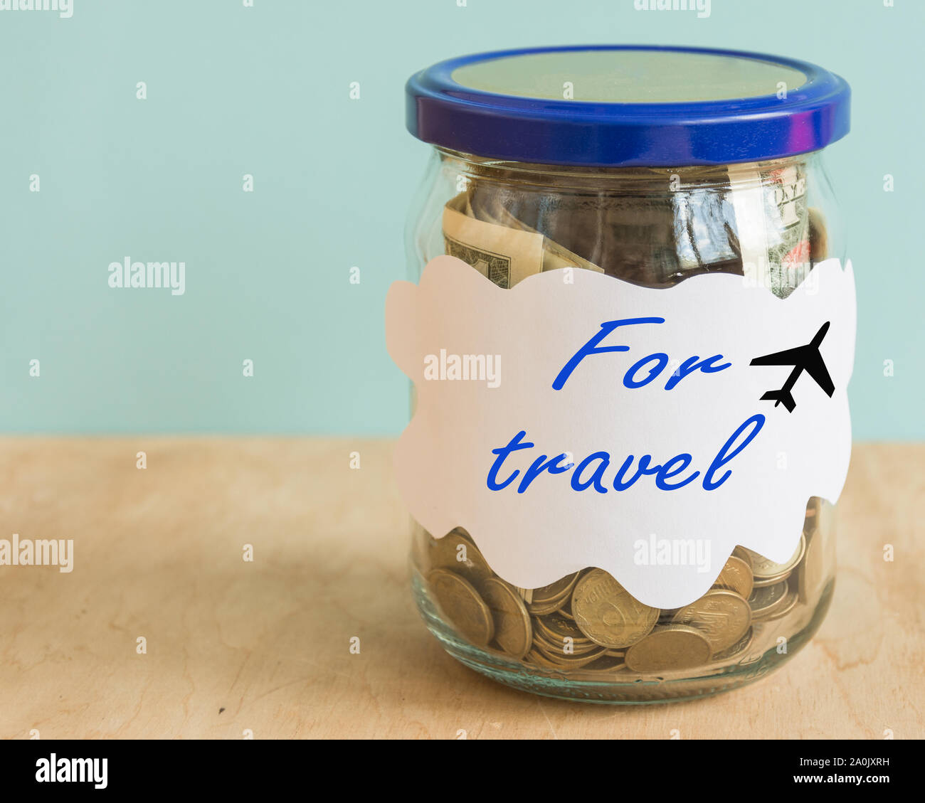 Jar With Coins And Currency Save Money For Travel Concepts Adventures Invest Creative Idea To Invest Currence For Travelling Stock Photo Alamy