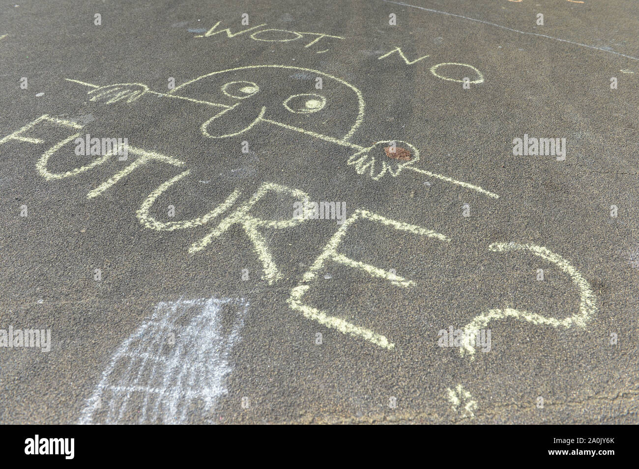 Glasgow, UK. 20 September 2019.  PICTURED: A chalk marked slogan which reads 'WOT NO FUTURE?' Will there be anything left for our future generations? Scenes from a planned protest in George Square this afternoon after strikes started a year ago by 16-year-old Swedish schoolgirl named Greta Thunberg. Hundreds of chalk marked slogans littered the concrete of George Square with protestors from all ages and backgrounds. Credit: Colin Fisher/Alamy Live News Stock Photo