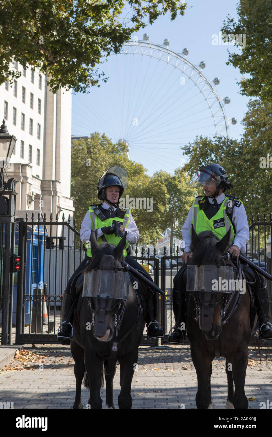 Westminster, London, UK. 20 September 2019. Police officers in Whitehall as Climate strike protesters demonstrate in Parliament Square.  Thousands of school children turn out for a global Climate Emergency Strike in London organised by the UK Student Climate Network. The message is for climate justice before the United Nations emergency climate summit on 23 September. Stock Photo
