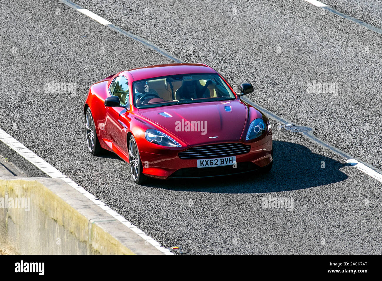 2012 Red Aston Martin Db9 Uk Vehicular Traffic Transport Modern Saloon Cars South Bound On The 3 Lane M6 Motorway Highway Stock Photo Alamy