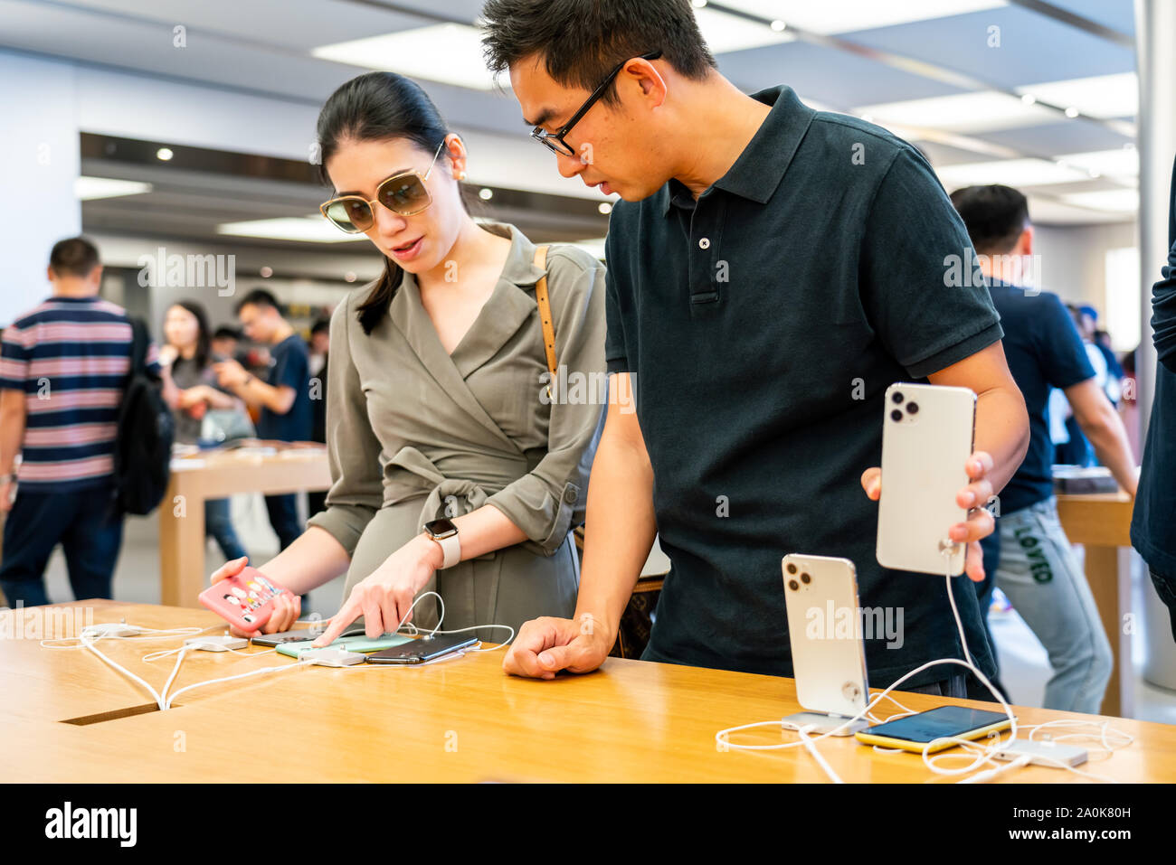 Customers look at Apple's new iPhone 11 series smartphones at an Apple retail store at the IFC Mall in Pudong New Area, Shanghai. Apple launched sales of its latest iPhone 11, iPhone 11 Pro and iPhone 11 Pro Max in China. Stock Photo
