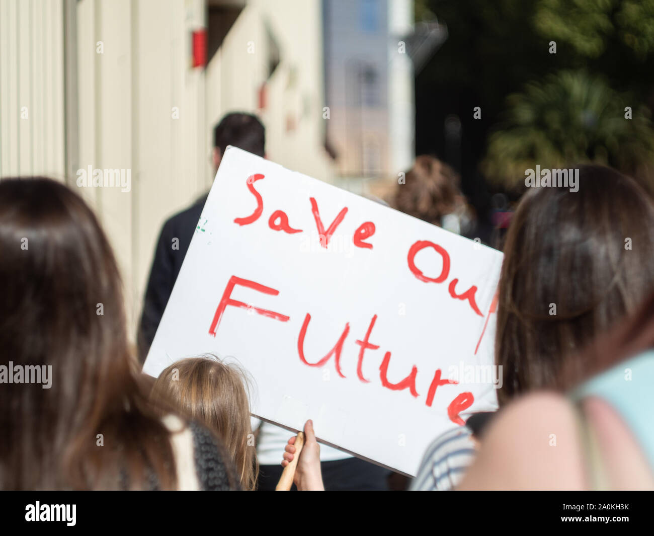LONDON, UK - SEPTEMBER 20 2019: Young girl holding a handwritten sign that reads 'Save our future' at the Global Climate Strike in London Stock Photo