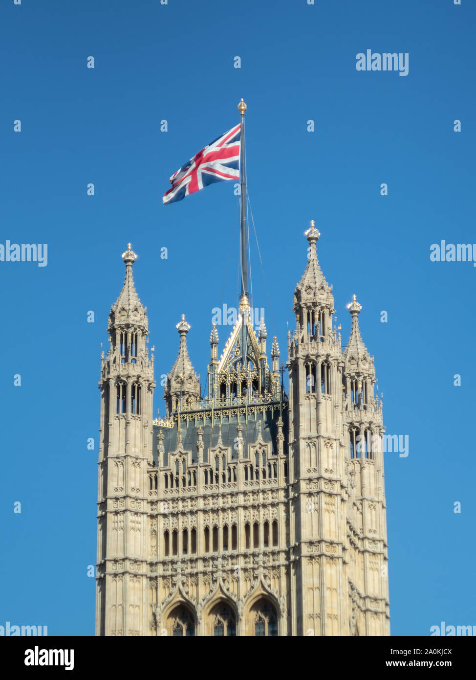 LONDON, UK - SEPTEMBER 20 2019: Union Jack flag flying over the Houses of Parliament against a blue sky, Westminster, London Stock Photo