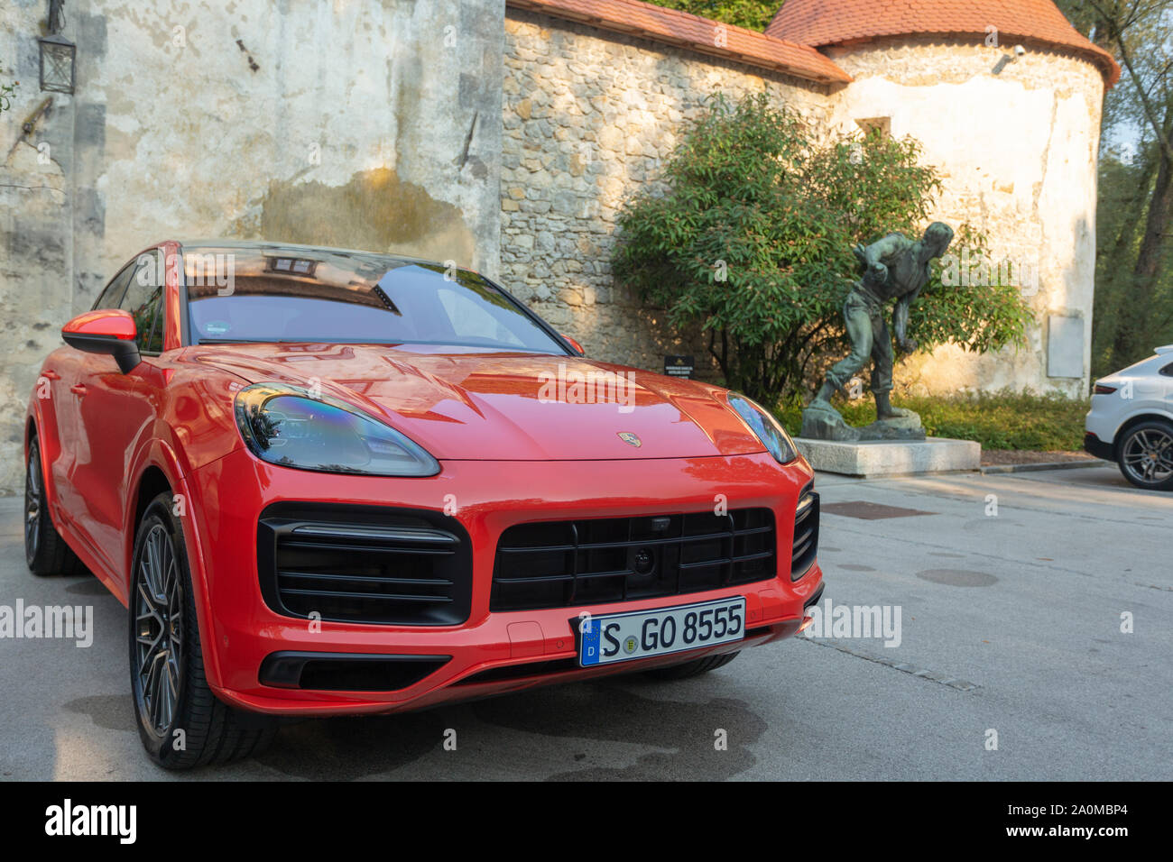 Slovenia Ljubljana 31 August 2019 Red Porsche Cayenne Coupe Turbo S From Stuttgart During Test Drive In Old Castle Stock Photo Alamy