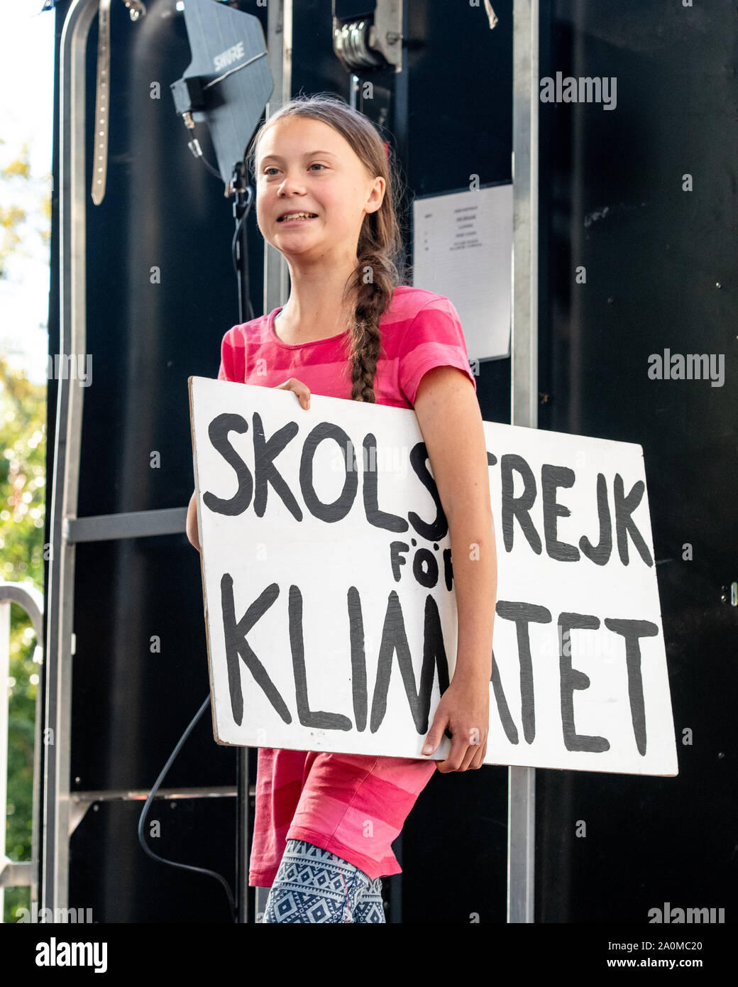 """New York, USA. 20th Sep, 2019. Swedish activist Greta Thunberg enters the stage to address a Climate Strike rally in New York City. Sign in Swedish reads: """" school march for the climate"""" Credit: Enrique Shore/Alamy Live News Stock Photo"""