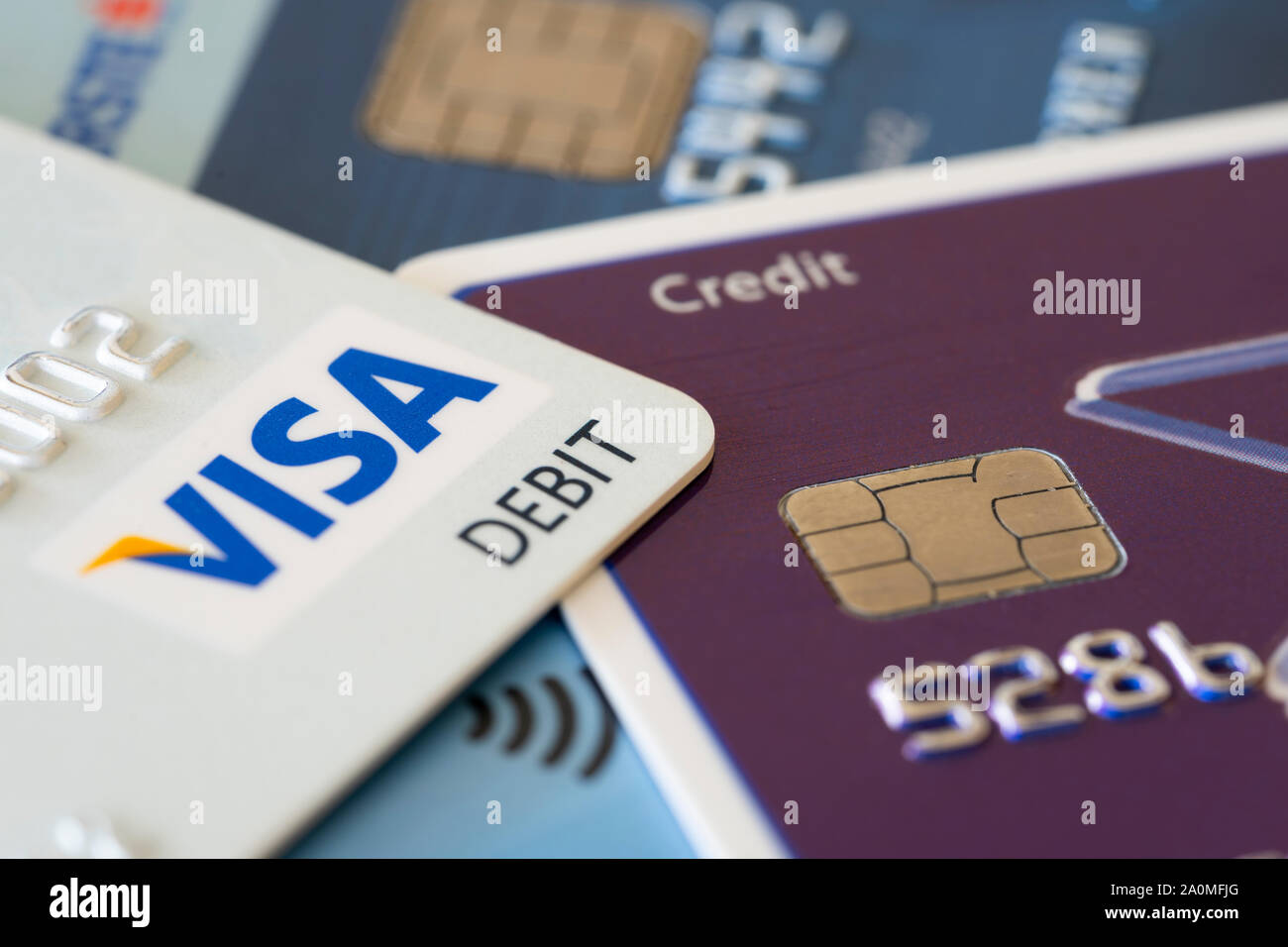 Debit Visa and Mastercard credit cards showing the concepts of finances and debt Stock Photo