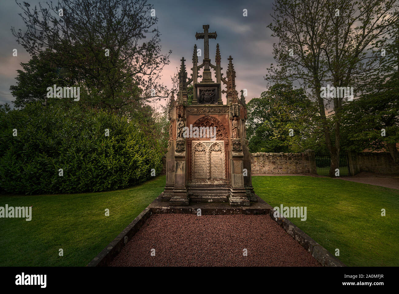 Grave at Rosslyn Chapel.  Rosslyn Chapel is a gothic church located at the village of Roslin, Midlothian, Scotland Stock Photo