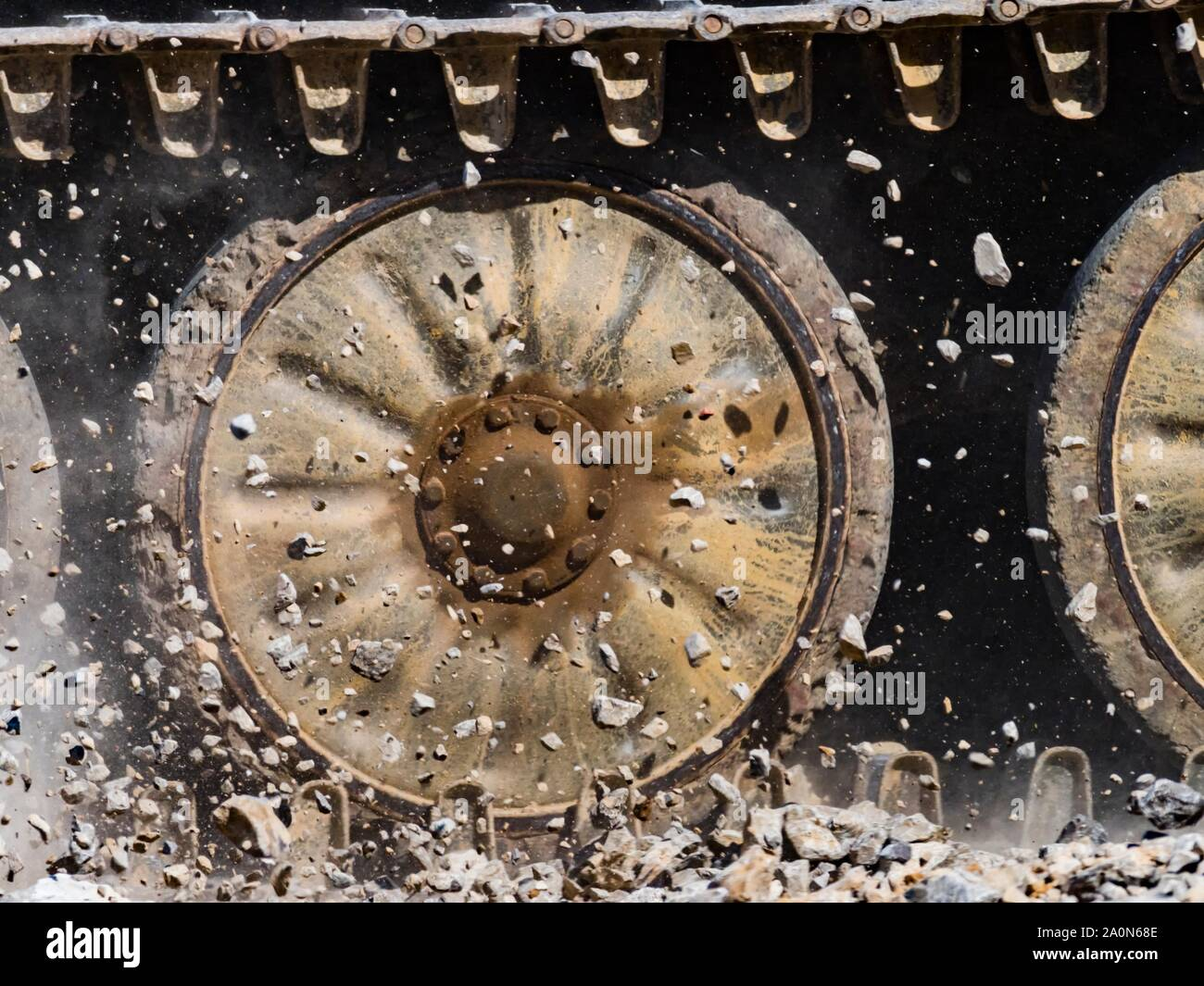 Tracks throwing rocks up frozen in mid-air midair Stock Photo