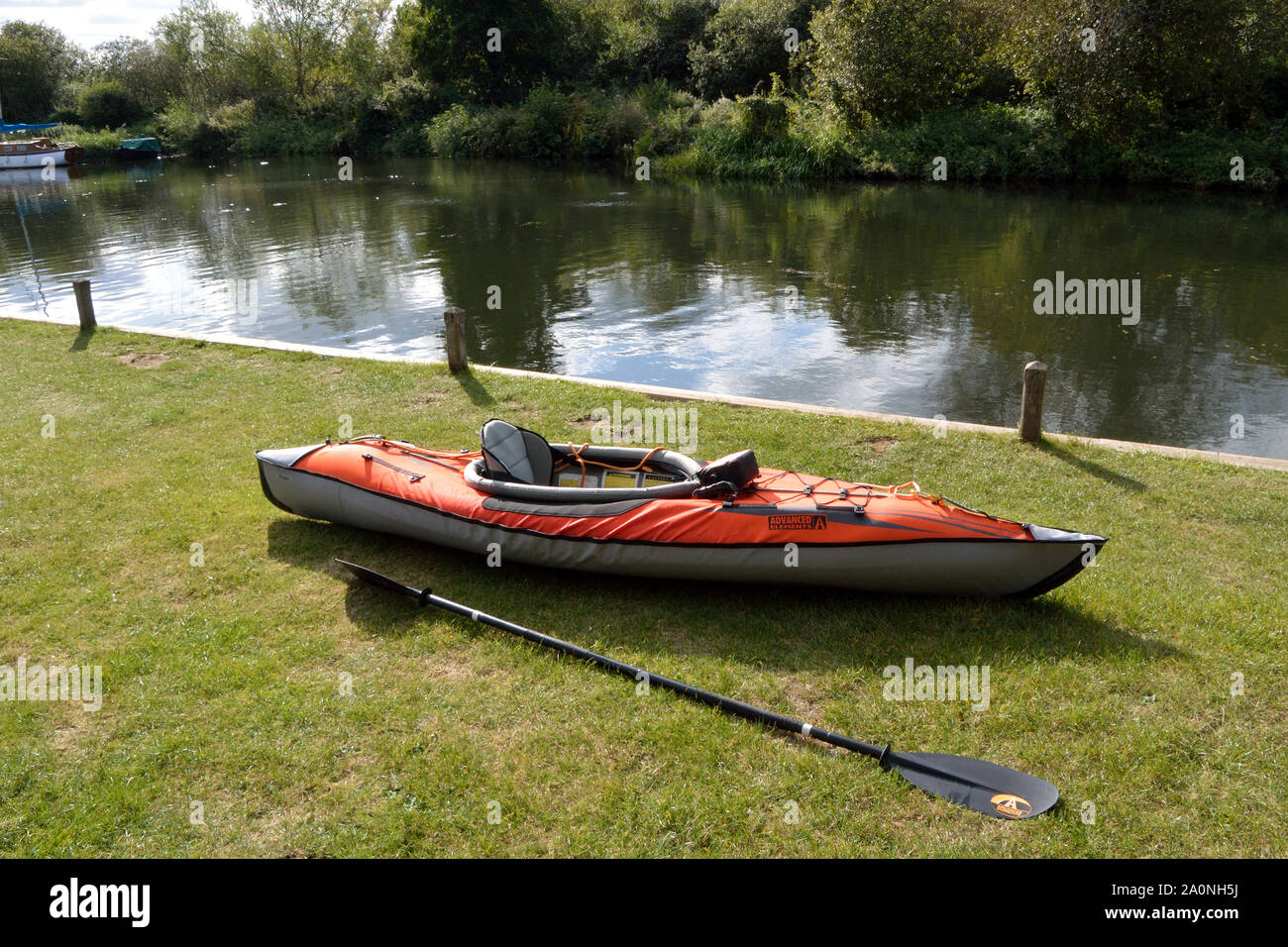 Advanced Elements inflatable kayak beside the River Bure at Belaugh staithe, Norfolk, Broads National Park Stock Photo
