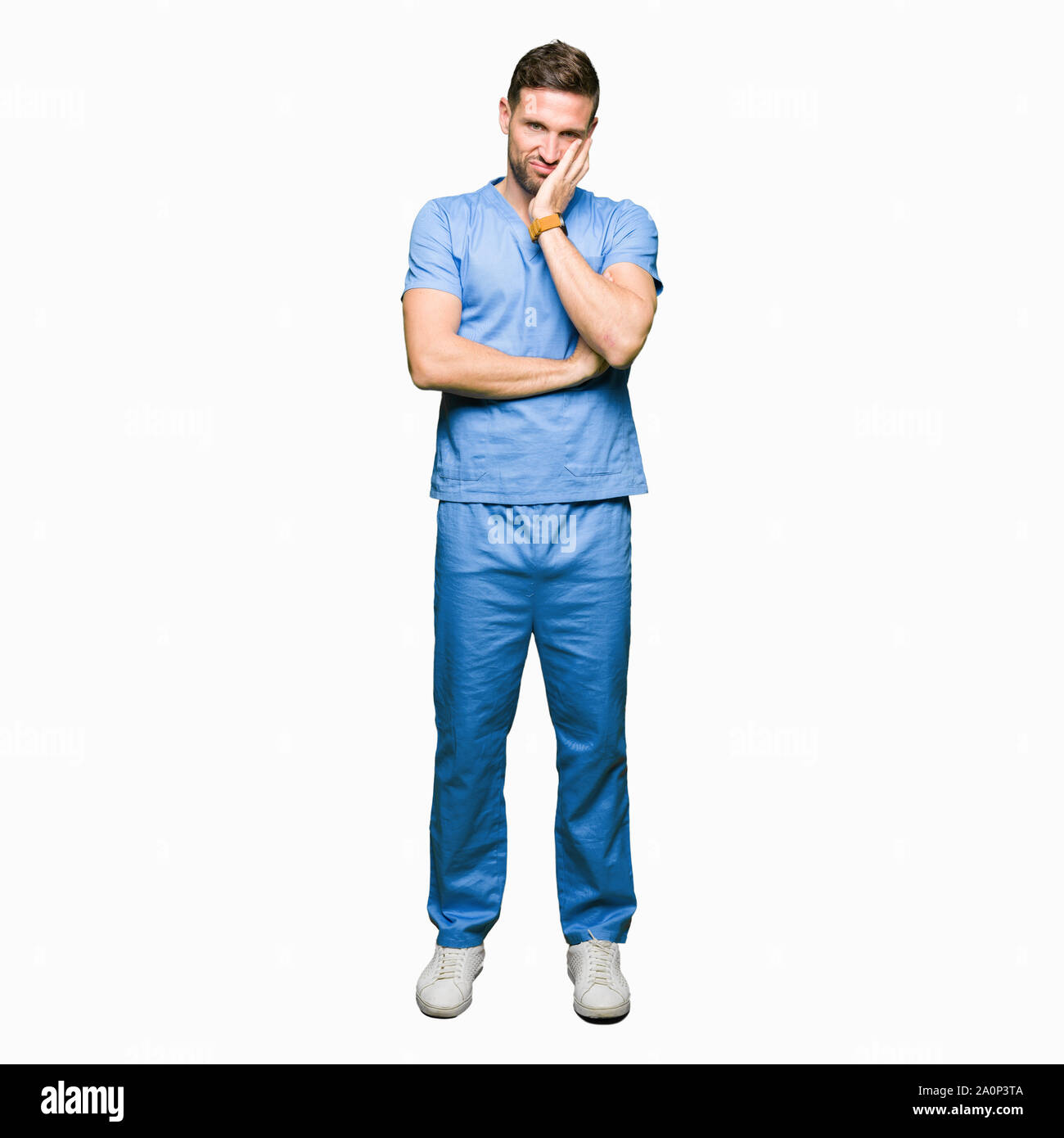 Handsome doctor man wearing medical uniform over isolated background thinking looking tired and bored with depression problems with crossed arms. Stock Photo