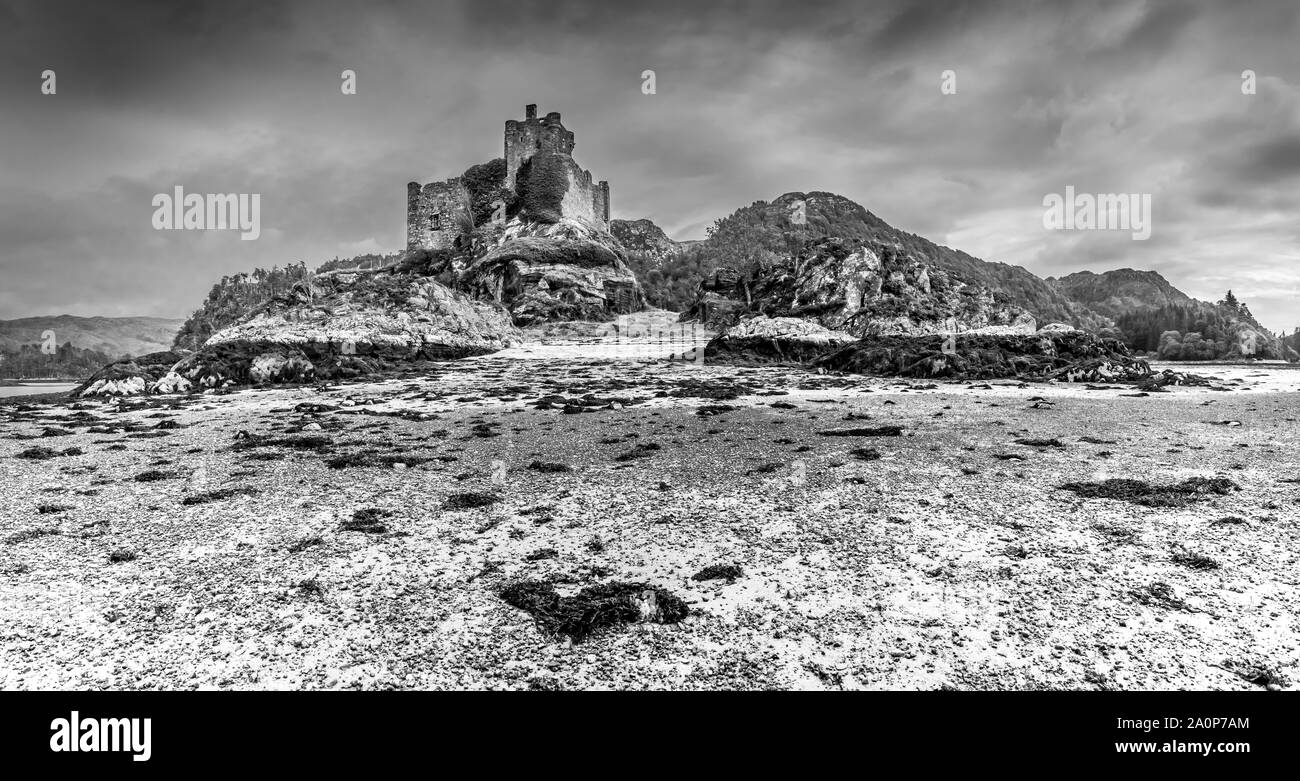 The ruins of the 13th century Eileen Tioram [The dry island] castle in the western Highland of Loch Moidart and River Shiel in monochrome Stock Photo