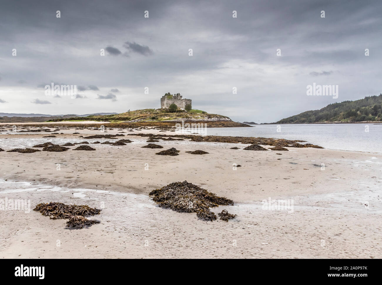 The ruins of the 13th century Eileen Tioram [The dry island] castle in the western Highland of Loch Moidart and River Shiel Stock Photo