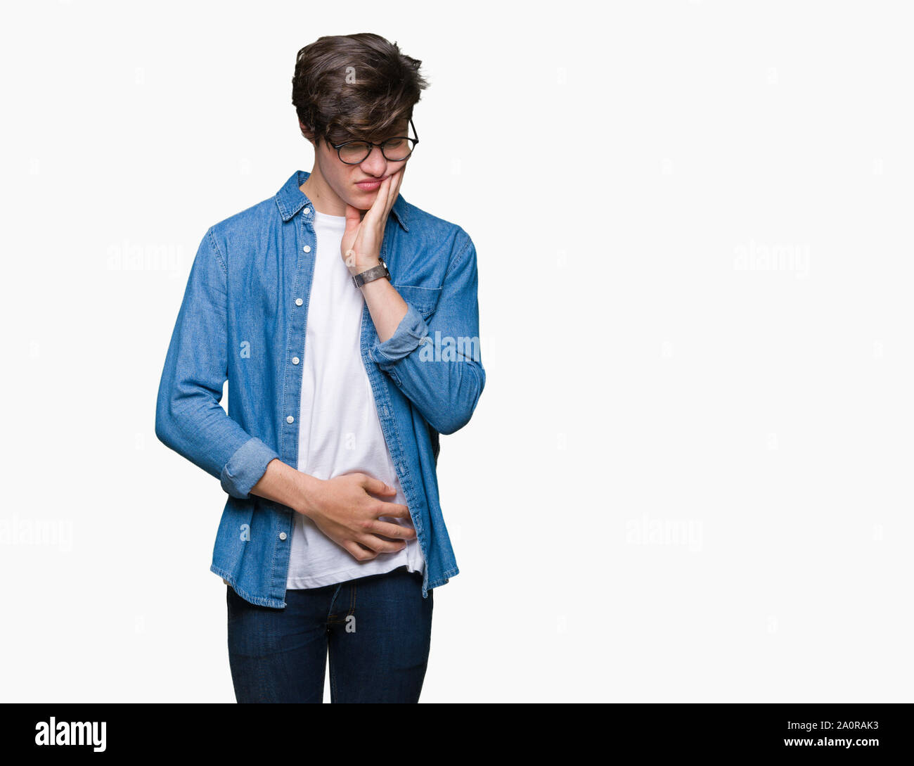 Young handsome man wearing glasses over isolated background thinking looking tired and bored with depression problems with crossed arms. Stock Photo