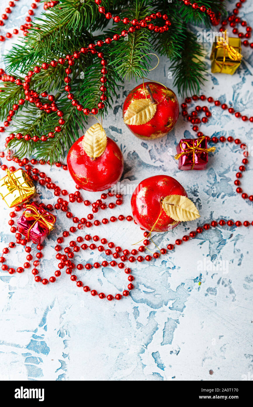 Christmas Decorations In The Form Of Apples Fir Branch And Red
