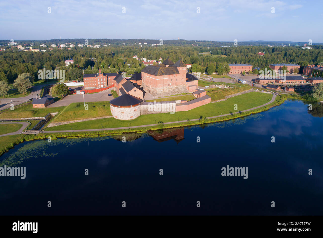 Hameenlinna fortress on the bank of the Vanayavesi lake in the solar July morning. Finland Stock Photo