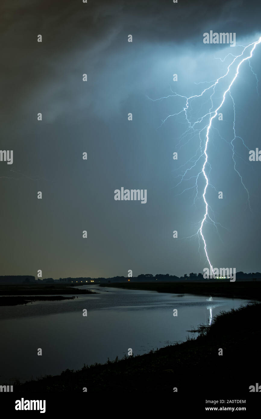 Multiple branched lightning bolt over a lake near Rotterdam, The Netherlands Stock Photo
