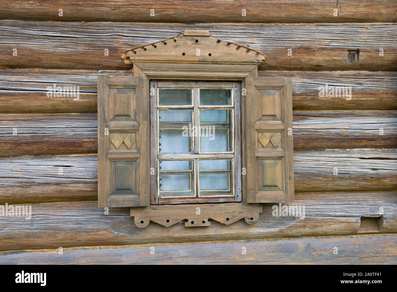 A Small Window With Shutters Of An Old Wooden House Close Up